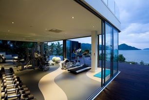 Contemporary Home Gym with picture window, can lights, Glass sliding door, Columns, Carpet, sliding glass door