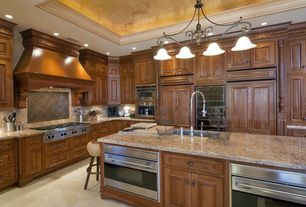 Traditional Kitchen with Wine refrigerator, Simple Granite, L-shaped, limestone tile floors, Simple granite counters