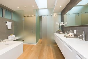 Modern Master Bathroom with Corian counters, Flush, Stone Tile, Hardwood floors, frameless showerdoor, Slate Tile