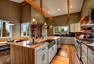 Country Kitchen with Flush, Breakfast nook, Soapstone counters, Wood counters, Breakfast bar, Exposed beam, European Cabinets