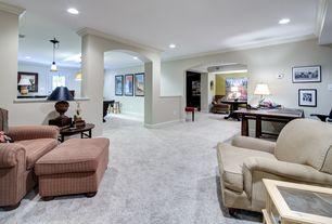 Traditional Basement with Columns, Paint 1, Carpet, can lights, Lay z boy chair, Paint 1, Crown molding, Standard height