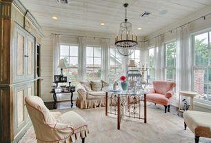 Eclectic Living Room with Built-in bookshelf, Hardwood floors, Chandelier, Crown molding