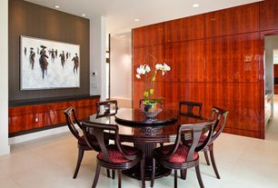 Asian Dining Room with stone tile floors, Rosewood round table with lazy susan, can lights, sandstone tile floors