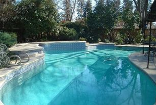Traditional Swimming Pool with Fence, exterior stone floors, Pool with hot tub