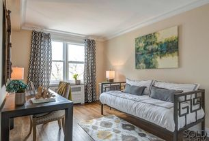 Traditional Guest Bedroom with Built-in bookshelf, Crown molding, double-hung window, Hardwood floors, Standard height