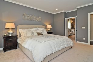 Traditional Master Bedroom with specialty door, Carpet, Mercury glass table lamp, Standard height, Crown molding, can lights