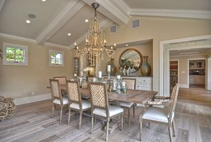 Contemporary Dining Room with High ceiling, Hardwood floors, Vintage french square fabric side chair, Chandelier