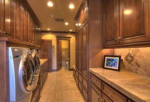 Traditional Laundry Room with Crown molding, Standard height, stone tile floors, laundry sink, can lights, specialty door