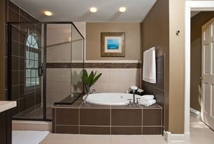 Contemporary Master Bathroom with Strands pearl 12 x 24 porcelain tile, Arched window, Handheld showerhead, Master bathroom