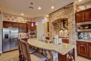 Traditional Kitchen with limestone tile floors, specialty door, Raised panel, Pendant light, MSI Alaska White Granite Slab