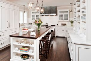 Traditional Kitchen with Crown molding, Kitchen island, Complex marble counters, Undermount sink, can lights, Hardwood floors