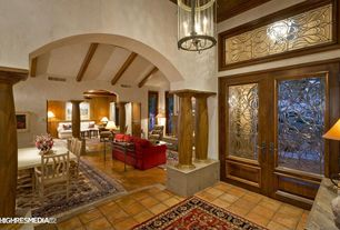Craftsman Entryway with terracotta tile floors, French doors, Columns, Transom window, Standard height, Pendant light