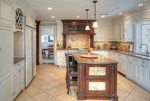 Traditional Kitchen with Raised panel, Custom hood, Kitchen island, Simple granite counters, U-shaped, Pendant light
