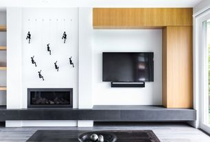 Modern Living Room with Built-in bookshelf, High ceiling, Hardwood floors