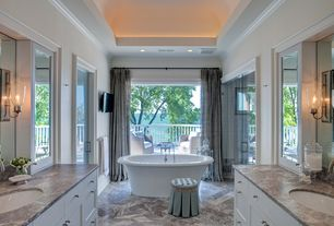 Traditional Master Bathroom with stone tile floors, Bathtub, Freestanding, Crown molding, Flat panel cabinets, Complex Marble
