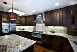 Traditional Kitchen with U-shaped, Flat panel cabinets, Split face tile, Stone Tile, Complex granite counters, Kitchen island