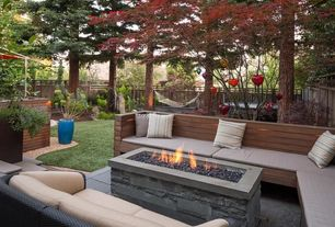 Contemporary Patio with Raised beds, Fire pit, exterior stone floors, Fence