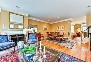 Traditional Great Room with French doors, Crown molding, Cement fireplace, Transom window, Hardwood floors