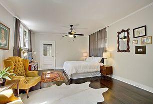 Eclectic Master Bedroom with double-hung window, Built-in bookshelf, Standard height, Ceiling fan, Glass panel door, Paint