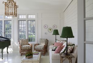 Cottage Living Room with Crown molding, Chandelier, simple marble floors, High ceiling, French doors