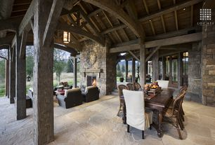 Rustic Patio with French doors, picture window, exterior stone floors