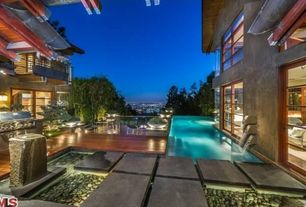 Contemporary Swimming Pool with Fence, Outdoor kitchen, exterior stone floors, Pathway
