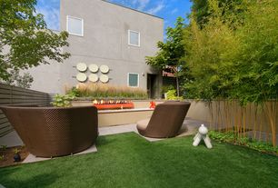 Contemporary Landscape/Yard with exterior tile floors, Raised beds, Fence, Fire pit