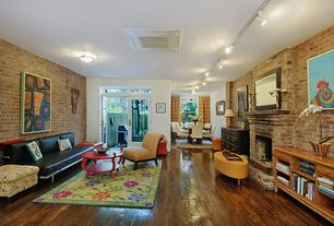 Eclectic Great Room with interior brick, Fireplace, double-hung window, flush light, Standard height, brick fireplace