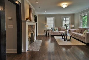 Contemporary Living Room with stone fireplace, Hardwood floors, Crown molding, flush light