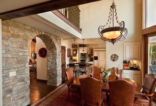 Mediterranean Dining Room with High ceiling, Laminate floors, flush light, Columns, Loft, Built-in bookshelf