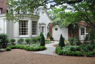 Traditional Landscape/Yard with Glass panel door, double-hung window, Pathway, specialty window, exterior stone floors