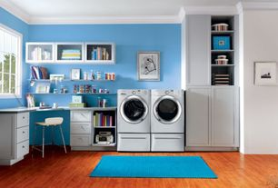 Traditional Laundry Room with Laminate floors, Built-in bookshelf, Crown molding, Area rug