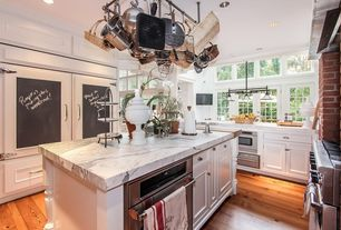 Traditional Kitchen with Inset cabinets, Kitchen island, Pental calacatta statuario polished marble, U-shaped, Transom window