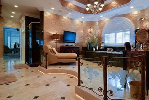 Traditional Master Bathroom with Crown molding, Standard height, stone tile floors, drop in bathtub, Bathtub, Arched window