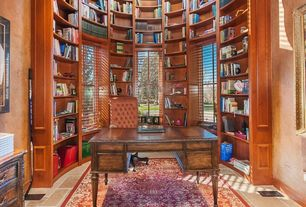 Traditional Library with sandstone tile floors, High ceiling, interior wallpaper, Built-in bookshelf