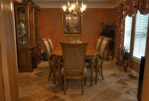 Traditional Dining Room with Built-in bookshelf, Chandelier, stone tile floors, picture window, Standard height, Paint