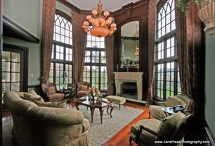 Traditional Living Room with specialty window, Cement fireplace, Crown molding, Chair rail, Chandelier, Hardwood floors