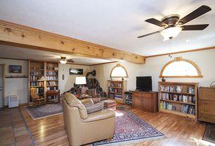 Craftsman Living Room with Crown molding, Exposed beam, Ceiling fan, Hardwood floors, Built-in bookshelf