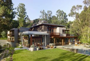 Contemporary Exterior of Home with Longboard aluminum siding, Eldorado stacking stone
