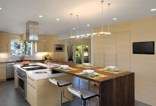 "Contemporary Kitchen with White quartz countertop in ""snowstorm"", two dishwashers, French doors, Corian counters, Casement"
