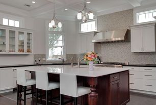 Contemporary Kitchen with Soapstone counters, Simple marble counters, Breakfast bar, Flat panel cabinets, Pendant light