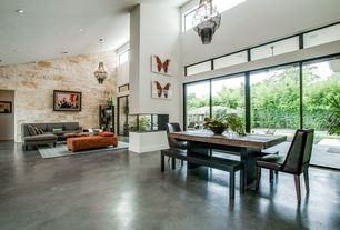 Modern Great Room with Concrete floors, Built-in bookshelf, High ceiling, Chandelier, Transom window