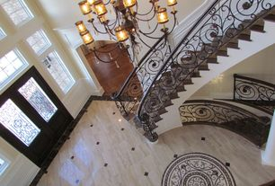 Traditional Staircase with Wainscotting, Cathedral ceiling, Hardwood floors, curved staircase
