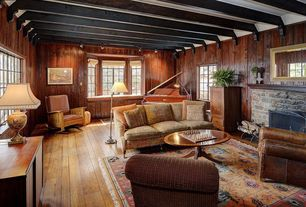 Rustic Living Room with Casement, Bay window, Hardwood floors, Exposed beam, Fireplace, flush light, stone fireplace