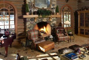 Rustic Living Room with stone fireplace, Fireplace, Arched window, Concrete floors, Standard height, Chandelier
