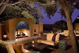 Mediterranean Patio with exterior brick floors, Fire pit, Fence