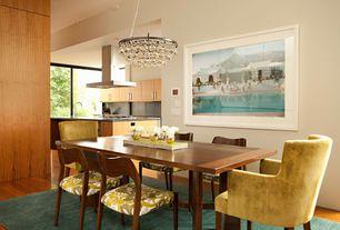 Modern Dining Room with Hardwood floors, Chandelier