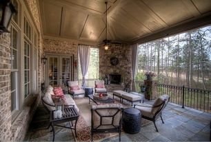 Country Porch with Ballard design suzanne kasler directoire lounge chair, French doors, Screened porch, exterior stone floors