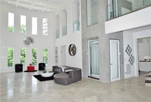 Modern Living Room with picture window, can lights, High ceiling, Paint, stone tile floors, simple marble tile floors