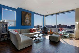 Modern Living Room with Paint, Hardwood floors, Ikea - dudero floor lamp, Armless sectional sofa, Glass coffee table, Ottoman